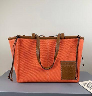 Loewe Cushion large leather-trimmed canvas tote Orange